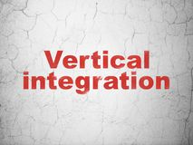Finance concept: Vertical Integration on wall background. Finance concept: Red Vertical Integration on textured concrete wall background Royalty Free Stock Photo