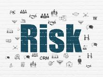 Finance concept: Risk on wall background. Finance concept: Painted blue text Risk on White Brick wall background with  Hand Drawn Business Icons Stock Images