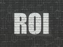 Finance concept: ROI on wall background Stock Photos