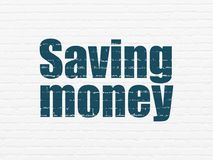 Finance concept: Saving Money on wall background. Finance concept: Painted blue text Saving Money on White Brick wall background Royalty Free Stock Images
