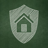 Finance concept: Shield on chalkboard background Royalty Free Stock Photography