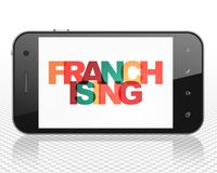 Finance concept: Smartphone with Franchising on  display. Finance concept: Smartphone with Painted multicolor text Franchising on display, 3D rendering Royalty Free Stock Photo