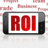 Finance concept: Smartphone with ROI on display. Finance concept: Smartphone with  red text ROI on display,  Tag Cloud background, 3D rendering Royalty Free Stock Photo