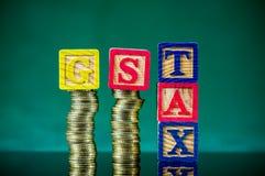 GST and TAX alphabet arrangement. Stock Photos