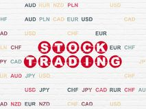 Finance concept: Stock Trading on wall background. Finance concept: Painted red text Stock Trading on White Brick wall background with Currency Royalty Free Stock Images