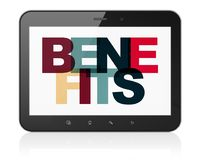 Finance concept: Tablet Computer with Benefits on  display. Finance concept: Tablet Computer with Painted multicolor text Benefits on display, 3D rendering Royalty Free Stock Photography