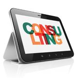 Finance concept: Tablet Computer with Consulting on  display. Finance concept: Tablet Computer with Painted multicolor text Consulting on display, 3D rendering Royalty Free Stock Photos