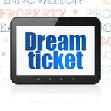 Finance concept: Tablet Computer with Dream Ticket on display. Finance concept: Tablet Computer with  blue text Dream Ticket on display,  Tag Cloud background Royalty Free Stock Photos