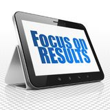Finance concept: Tablet Computer with Focus on RESULTS on display. Finance concept: Tablet Computer with blue text Focus on RESULTS on display, 3D rendering Royalty Free Stock Photos