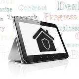 Finance concept: Tablet Computer with Home on display. Finance concept: Tablet Computer with  black Home icon on display,  Tag Cloud background, 3D rendering Stock Photo