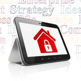 Finance concept: Tablet Computer with Home on display. Finance concept: Tablet Computer with  red Home icon on display,  Tag Cloud background, 3D rendering Royalty Free Stock Photography