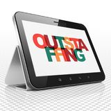 Finance concept: Tablet Computer with Outstaffing on  display. Finance concept: Tablet Computer with Painted multicolor text Outstaffing on display, 3D rendering Stock Photo