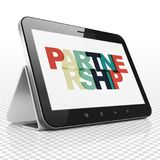 Finance concept: Tablet Computer with Partnership on  display. Finance concept: Tablet Computer with Painted multicolor text Partnership on display, 3D rendering Royalty Free Stock Photos