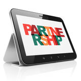 Finance concept: Tablet Computer with Partnership on  display. Finance concept: Tablet Computer with Painted multicolor text Partnership on display Stock Photography