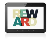 Finance concept: Tablet Computer with Reward on  display. Finance concept: Tablet Computer with Painted multicolor text Reward on display, 3D rendering Royalty Free Stock Images
