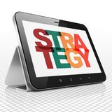 Finance concept: Tablet Computer with Strategy on  display. Finance concept: Tablet Computer with Painted multicolor text Strategy on display, 3D rendering Royalty Free Stock Photo