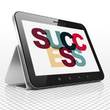 Finance concept: Tablet Computer with Success on  display. Finance concept: Tablet Computer with Painted multicolor text Success on display, 3D rendering Stock Photography