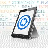 Finance concept: Tablet Computer with Target on display. Finance concept: Tablet Computer with  blue Target icon on display,  Tag Cloud background, 3D rendering Royalty Free Stock Photos