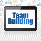Finance concept: tablet computer with team building on display. Finance concept: tablet computer with  blue text team building on display, hand drawn business Royalty Free Stock Image