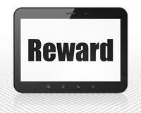 Finance concept: Tablet Pc Computer with Reward on display. Finance concept: Tablet Pc Computer with black text Reward on display, 3D rendering Royalty Free Stock Photo