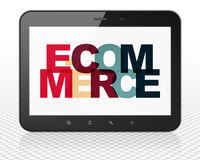 Finance concept: Tablet Pc Computer with E-commerce on  display. Finance concept: Tablet Pc Computer with Painted multicolor text E-commerce on display, 3D Royalty Free Stock Photo