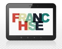 Finance concept: Tablet Pc Computer with Franchise on  display. Finance concept: Tablet Pc Computer with Painted multicolor text Franchise on display, 3D Royalty Free Stock Photography