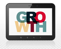 Finance concept: Tablet Pc Computer with Growth on. Finance concept: Tablet Pc Computer with Painted multicolor text Growth on display Royalty Free Stock Photo