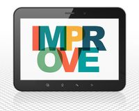Finance concept: Tablet Pc Computer with Improve on  display. Finance concept: Tablet Pc Computer with Painted multicolor text Improve on display, 3D rendering Royalty Free Stock Photo