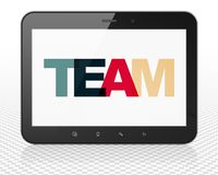 Finance concept: Tablet Pc Computer with Team on  display. Finance concept: Tablet Pc Computer with Painted multicolor text Team on display, 3D rendering Royalty Free Stock Image