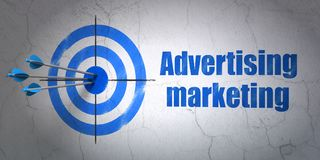 Finance concept: target and Advertising Marketing on wall background. Success finance concept: arrows hitting the center of target, Blue Advertising Marketing on Royalty Free Stock Photography