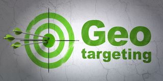 Finance concept: target and Geo Targeting on wall background. Success finance concept: arrows hitting the center of target, Green Geo Targeting on wall Stock Photo