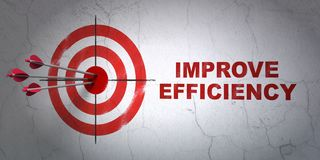 Finance concept: target and Improve Efficiency on wall background. Success finance concept: arrows hitting the center of target, Red Improve Efficiency on wall Royalty Free Stock Photos