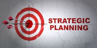 Finance concept: target and Strategic Planning on wall background. Success finance concept: arrows hitting the center of target, Red Strategic Planning on wall Stock Photography