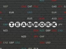 Finance concept: Teamwork on wall background. Finance concept: Painted white text Teamwork on Black Brick wall background with Currency Stock Images