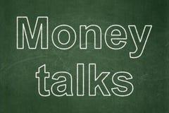 Finance concept: Money Talks on chalkboard background. Finance concept: text Money Talks on Green chalkboard background Royalty Free Stock Images