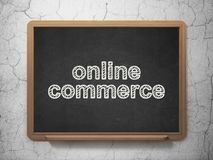 Finance concept: Online Commerce on chalkboard background. Finance concept: text Online Commerce on Black chalkboard on grunge wall background, 3D rendering Stock Photo
