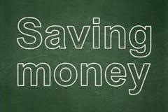 Finance concept: Saving Money on chalkboard background. Finance concept: text Saving Money on Green chalkboard background Royalty Free Stock Photo