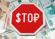 Finance concept with USD and Russian money as a stop road sign i Stock Photos