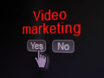 Finance concept: Video Marketing on digital. Finance concept: buttons yes and no with pixelated word Video Marketing and Hand cursor on digital computer screen Royalty Free Stock Image
