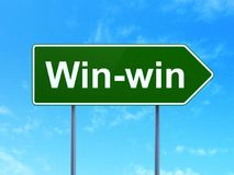 Finance concept: Win-Win on road sign background. Finance concept: Win-Win on green road highway sign, clear blue sky background, 3D rendering Royalty Free Stock Photos