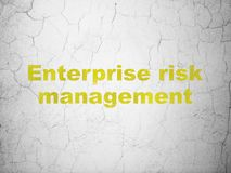 Finance concept: Enterprise Risk Management on wall background. Finance concept: Yellow Enterprise Risk Management on textured concrete wall background Royalty Free Stock Image