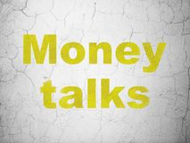 Finance concept: Money Talks on wall background. Finance concept: Yellow Money Talks on textured concrete wall background Royalty Free Stock Photo