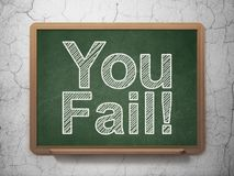 Finance concept: You Fail! on chalkboard background. Finance concept: text You Fail! on Green chalkboard on grunge wall background, 3D rendering Royalty Free Stock Photo