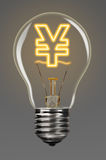 Finance creativity. Bulb with glowing yen sign inside of it, financial creativity concept Stock Photography