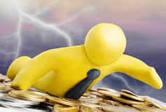 Finance crisis. Plasticine businessman swim through gold coins in stormy weather royalty free stock photos