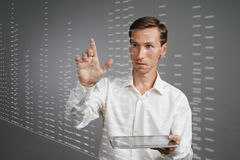 Finance data concept. Man working with Analytics. Chart graph information on digital screen. Royalty Free Stock Photos