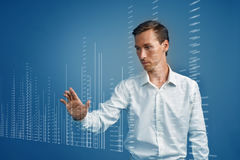 Finance data concept. Man working with Analytics. Chart graph information on digital screen. Stock Photos