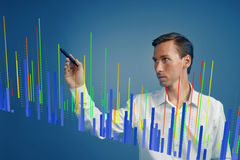 Finance data concept. Man working with Analytics. Chart graph information on digital screen. Stock Photography