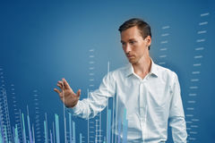 Finance data concept. Man working with Analytics. Chart graph information on digital screen. Royalty Free Stock Photography