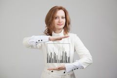 Finance data concept. Woman working with Analytics. Chart graph information on digital screen. Finance data concept. Young Woman working with Analytics. Chart Royalty Free Stock Photos